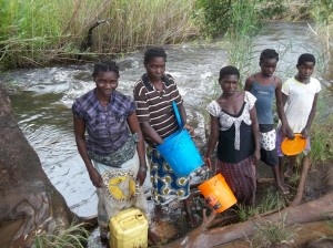 Women and girls spend hours walking to obtain water. Help us provide a clean water source near their homes!